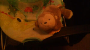 Baby recliner , floor mat ,and a stuff toy that plays music