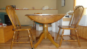 Sold wood table and 2 chairs