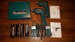 2 Makita cordless drills, 2 chargers, 4 batteries and metal case