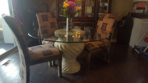 High end glass table set with 6 chairs