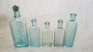 Five Vintage Bottles Rawleighs