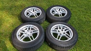 Set of  winter tires  185/65/14 + set of 4 mags