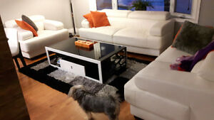 3 piece living room set with a modern coffee table