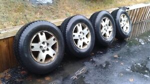 (4) Winters Tires - 235/70R16 106S On Ford Escape Rims