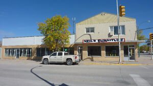 Dual zone COM/RES Building on high-traffic corner lot in The Pas