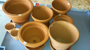 Clay planter pots..larger ones are plastic