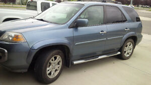 2005 Acura MDX  loaded and 2004 Chevy Avalanche loaded