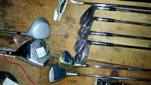 Used golf clubs plus new wilson driver