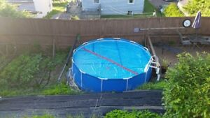 14 foot pool with 3 solar panels