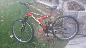 Huffy tundra, mountain bike. Dual suspension.