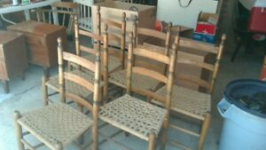 Six Canadiana ladder-back chairs with sea-grass seats.