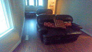 Loveseat and couch black and a brown couch and loveseat leather Regina Regina Area image 1