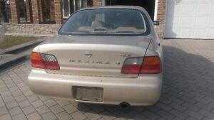 $1000 Nissan Maxima GLE as is.
