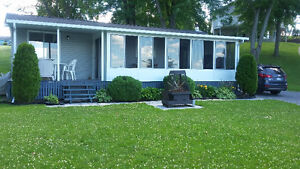 Custom built, waterfront cottage in adult campground