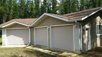 Acreage with large garage...serviced
