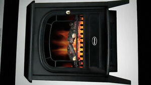Electric fireplace heater.  Variable fan speed and tempature