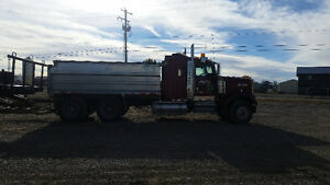 2005 KW gravel truck and quad trailer.