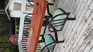 iron frame with 6 swivel chairs and wooden table