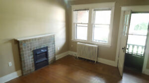 AVAILABLE NOW-MAINFLOOR 2bed w/BALCONY, HEAT & LAUNDRY ON SITE