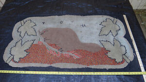 Antique beaver hooked rug, with 4 maple leaves