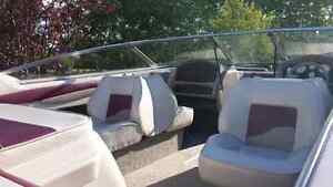 Reinell 19 ft boat with trailer