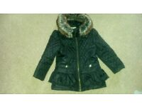 JULIEN MACDONALD, DESIGNERS AT DEBENHAMS, BLACK PEPLUM STYLE, QUILTED COAT. AGE 4 - 5.