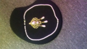 Pearl necklace and brooch