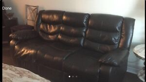 Dark brown reclining leather sofa and love seat