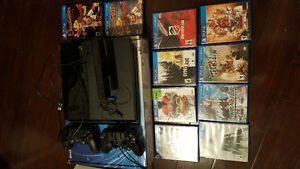 PS4 console, 2 controllers, and 4 games!