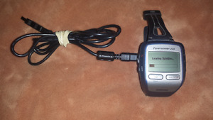 For sale, forerunner Garmin GPS watch. With charger station.