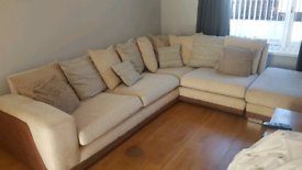 Corner settee in beige, brown trim