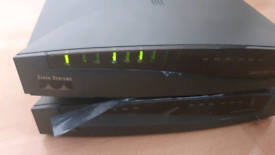 Cisco 801 Routers x 2 - Both with own power cables