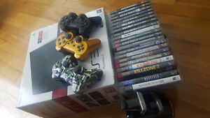 PlayStation 3 (slim) / 4 controllers / 20 games