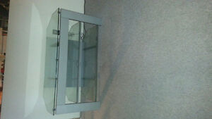 CLEAR GLASS T.V STAND