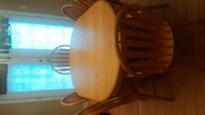 Solid Oak pedestal table and six oak chairs