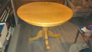 Round pedestal style dining table