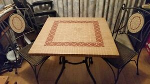 rod iron table and chairs with ceramic table top