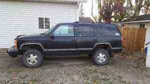 1999 Chevrolet Tahoe with iron cross bumber and winch