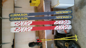 two pairs of skis for sale