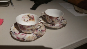 Two beautiful porcelain cups and saucers only 2 pieces. $50