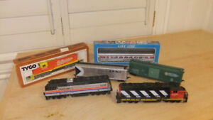 train tracks,hobby transformer and train engines and cars