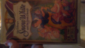 Vhs sealed snow white and non sealed beauty and the beast