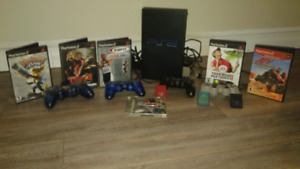 PS2 consol with games and controllers and memory cards