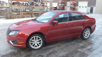 12 FUSION - auto - LOADED - AWD - LEATHER - STARTER - ONLY 73KMS
