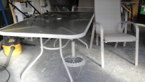 Patio table, six chairs, umbrella and stand