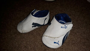 BRAND NEW Blue and white Pumas size 2