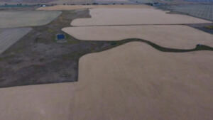 130 Acre Parcel is 21km to Okotoks and 15km away from High River