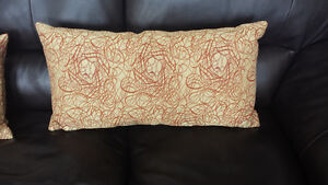 Two decorative pillows with zippered cushion cover