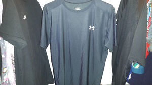 Under Armour Shirt XXL fits like a large