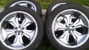 Four chrome aluminum  rims with tires